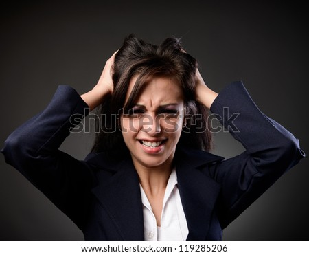 Studio portrait of a young businesswoman with strong headache - stock photo