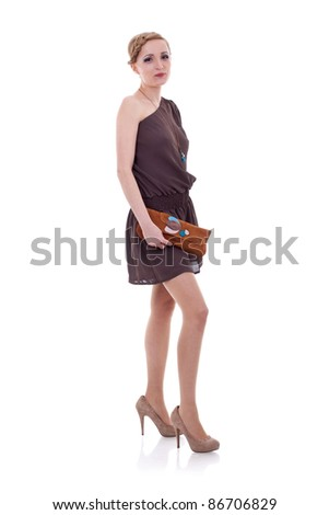 Studio portrait of a young woman with a purse isolated on white background - stock photo