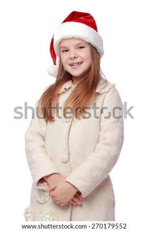 Studio portrait of adorable happy little girl with long beautiful hair with a Santa hat isolated on white/Christmas portrait of a cute child in a Santa's hat - stock photo