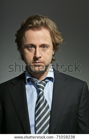 Studio portrait of angry young business man. Serious. Power. Boss. Concentration. - stock photo