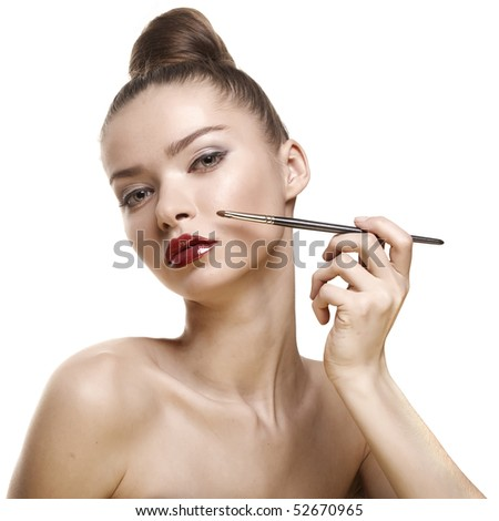 studio portrait of attractive young woman with lips-brush on white background