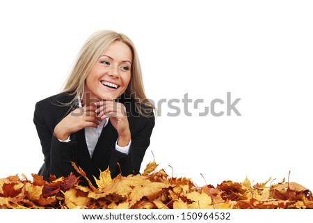 studio portrait of autumn business woman in  yellow leaves - stock photo