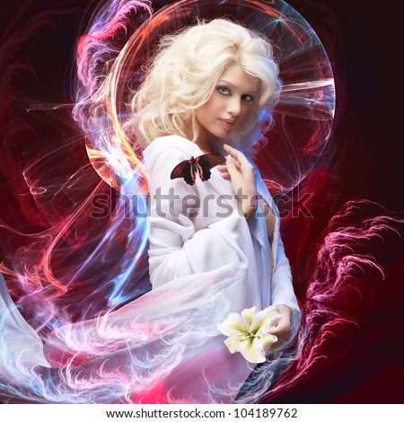 studio portrait of beautiful blonde tropical butterfly sitting on her shoulder on abstract lighting background