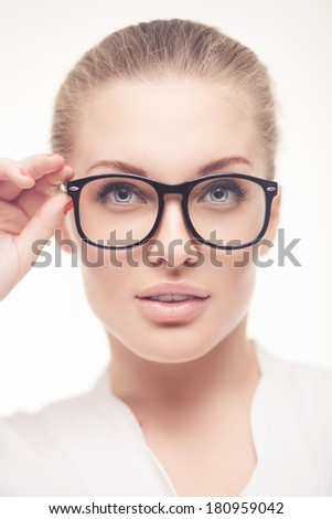 studio portrait of beautiful business woman in glasses - stock photo