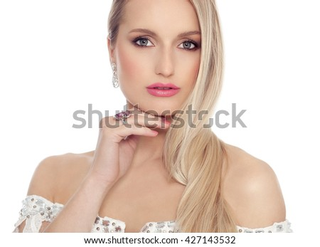 Studio portrait of beautiful Caucasian woman with long blond hair and pink lipstick and flower ring.