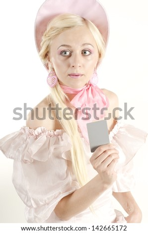 Studio portrait of beautiful woman dressed in old fashionable style with grey card