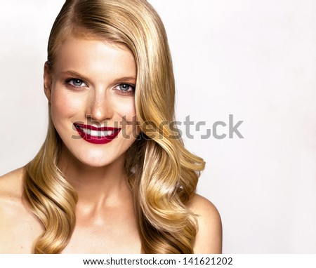 Studio portrait of beautiful young smiling woman
