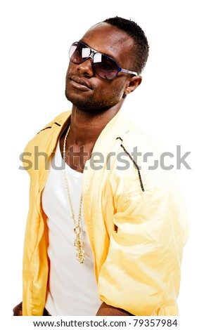 Studio portrait of cool black gangster rapper with yellow jacket and sunglasses. Isolated on white background. - stock photo