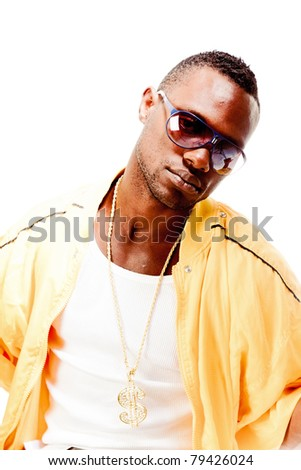 Studio portrait of cool gangster rapper with sunglasses and yellow jacket. Isolated on white background. - stock photo