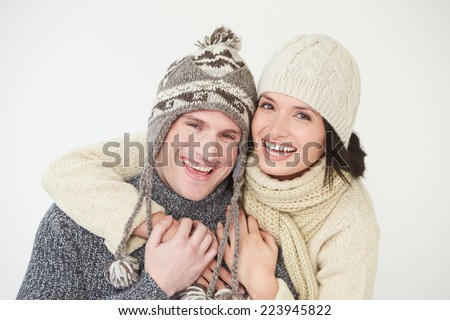 Studio Portrait Of Couple Wearing Warm Winter Clothes - stock photo