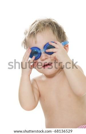 studio portrait of cute child in swim glasses - stock photo