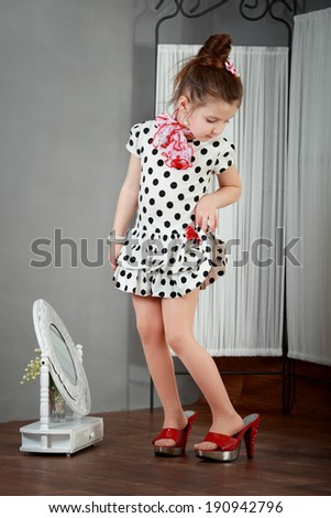 Studio portrait of cute little princess wearing beautiful tutu s - stock photo