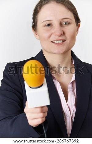 Studio Portrait Of Female Journalist With Microphone - stock photo