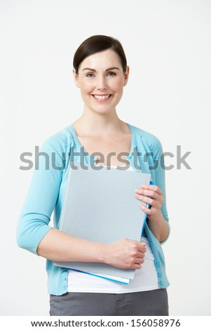 Studio Portrait Of Female Pre School Teacher - stock photo