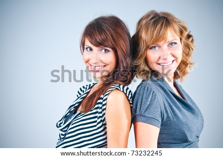 Studio portrait of girlfriends - stock photo