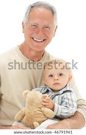 Studio Portrait Of Grandfather Holding Grandson With Teddy Bear - stock photo