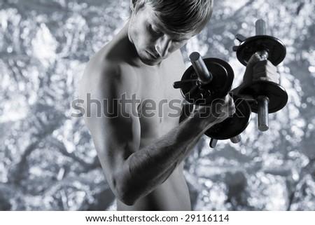 studio portrait of handsome blond man torso naked doing workout - stock photo