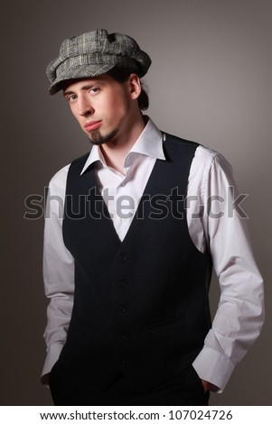 Studio portrait of handsome young man in old fashioned cloth - stock photo
