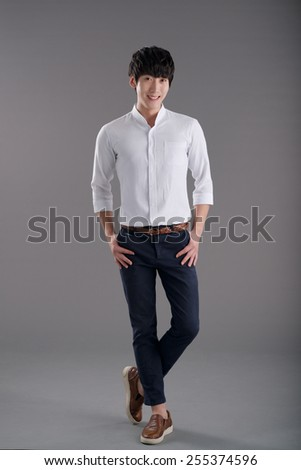 Studio portrait of Korean young man - stock photo