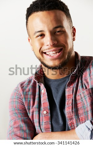 Studio Portrait Of Laughing Man Against White Background - stock photo