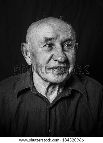 Studio portrait of laughing old man - stock photo