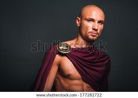 Studio portrait of man in spartan costume - stock photo