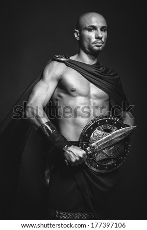 Studio portrait of man in spartan costume - stock photo