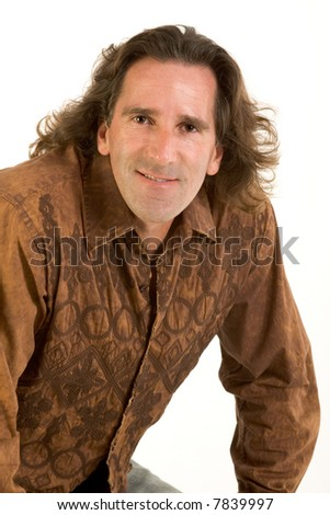 Studio portrait of mid aged man with long hair - stock photo