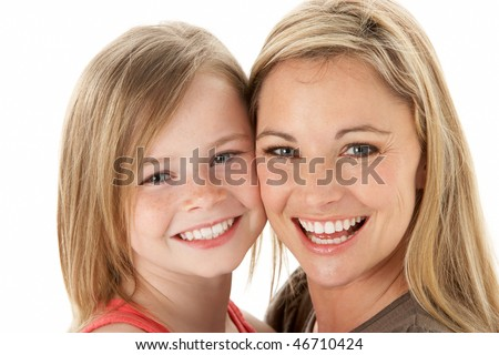 Studio Portrait Of Mother Hugging Young Daughter