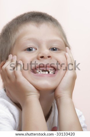 Studio portrait of  nice little boy having good time
