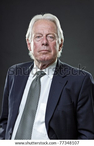 Studio portrait of senior business man looking dominant. - stock photo