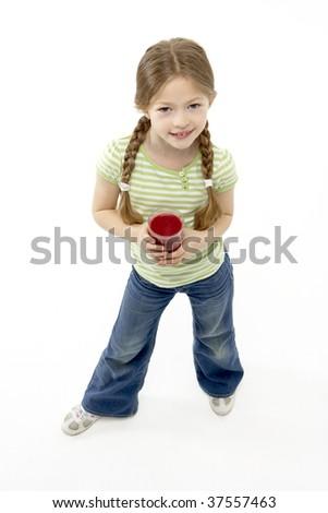 Studio Portrait of Smiling Girl Holding Glass of Juice - stock photo