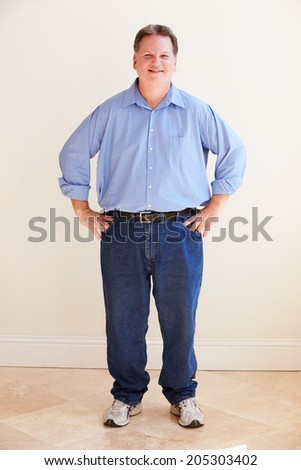 Studio Portrait Of Smiling Overweight Man - stock photo