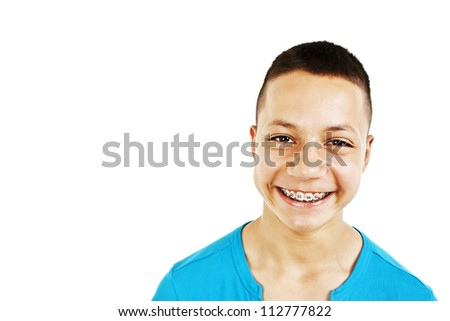 Studio Portrait of Smiling Teenage Boy. Isolated On a  White Background.