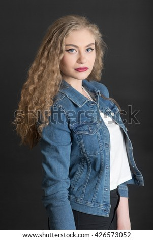studio portrait of the blonde with long hair - stock photo