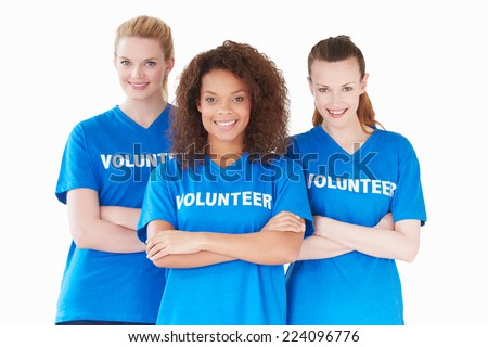 Studio Portrait Of Three Women Wearing Volunteer T Shirts - stock photo