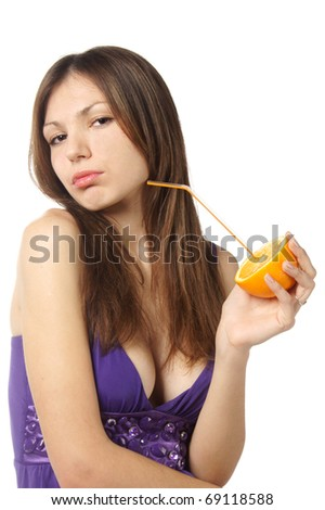 studio portrait of young attractive woman drinking fresh orange isolated against white background - stock photo