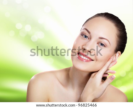 Studio portrait of young beautiful woman natural look - stock photo
