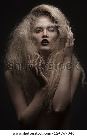 studio portrait of young beauty woman with stylish makeup on black background - stock photo