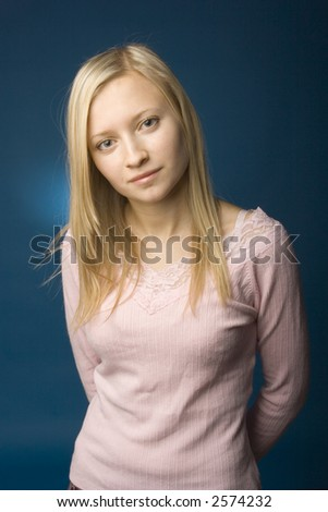 Studio portrait of young blonde woman. She is looking at the camera. - stock photo