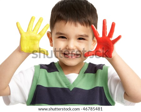 Studio Portrait Of Young Boy With Painted Hands - stock photo