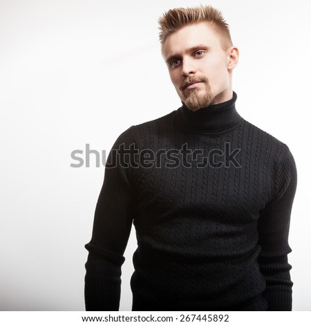 Studio portrait of young handsome man in knitted sweater. Close-up photo. - stock photo