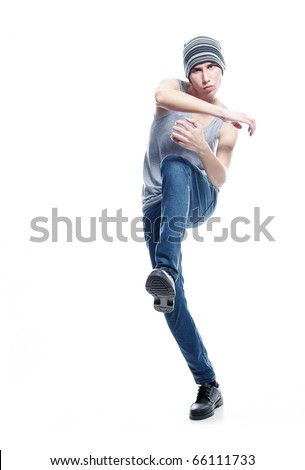 studio portrait of young hip-hop dancer over white - stock photo