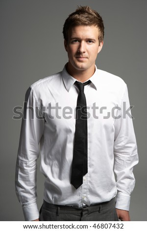 Studio Portrait Of Young Man Wearing Shirt And Tie - stock photo
