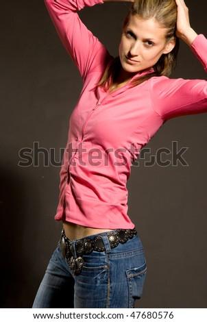 Studio portrait of young pretty woman - stock photo