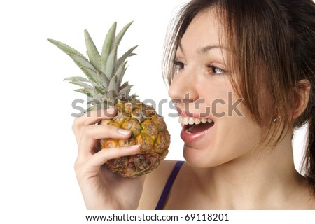studio portrait of young pretty woman holding pineapple isolated against white background - stock photo