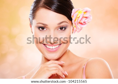 studio portrait of young smiley woman against blurred background