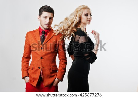 Studio portrait of young stylish beautiful couple. Girl's hair in the air
