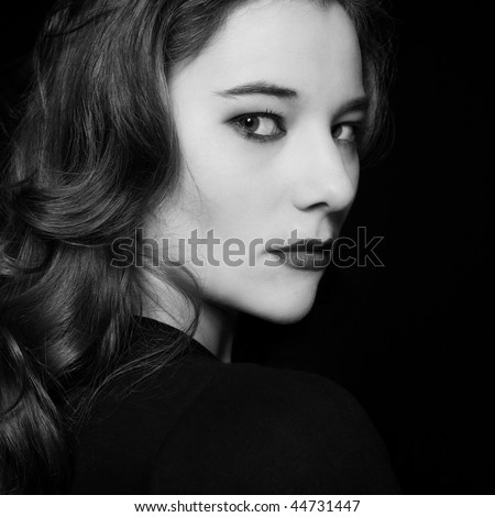 studio portrait on black background of an expressive woma - stock photo