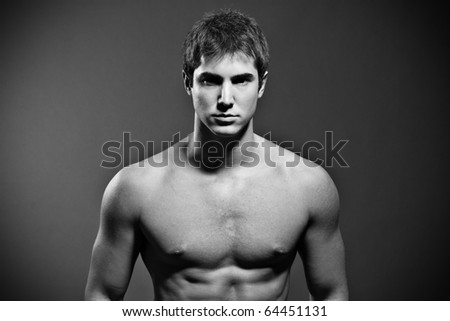 Studio portrait on muscular young man - stock photo